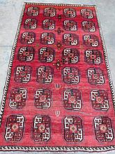 A Turkman rug, red ground with black, white and