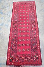 A Baluchi traditional style runner, on red ground