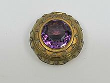 A gilt metal pillpot with paste amethyst in lid,