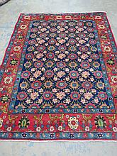 A Veramin rug 203x155cm red border around blue