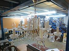 A twelve branch brass and cut-glass electrolier,