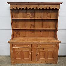 A 20thC waxed pine dresser, the top with twin