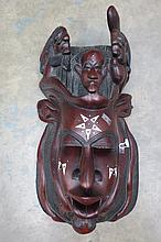 A well carved ethnic head mask inset with bone