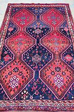 A traditional style Luri rug in red and blue