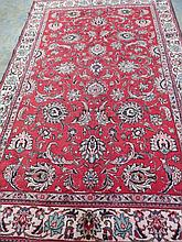 A traditional pattern Tabriz rug on red ground,