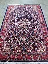 A fine Kashan rug 208x136cm Red and blue with a