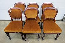 A set of six early 19thC mahogany dining chairs