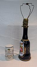 A large ceramic and brass table lamp with floral