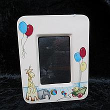 A Moorcroft nursery design photograph frame,