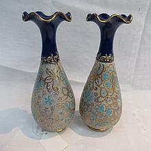 A pair of small Doulton stoneware vases, with a