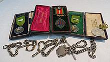 Two HM silver watch chains (2.44ozt) and another;