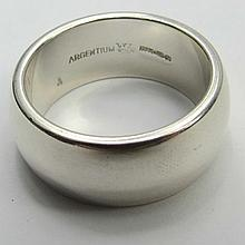 A Britannia silver band of a broad rounded form.