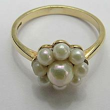 A 9ct gold dress ring, floral set with a central