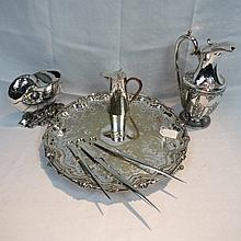 A silver plated nautilus shell spoon warmer, an