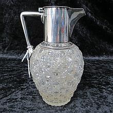 A cut glass claret jug with Christopher Dresser