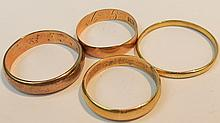 Four plain bands, one marked 750, one marked 585