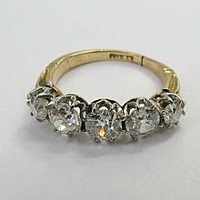 A five stone diamond half hoop ring, old cut