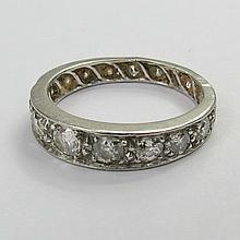 An unusual graduated full diamond eternity ring