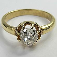 A single stone diamond ring. 'Hobnail' cut cushion