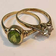 An oval faceted peridot ring, rub over setting,
