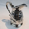 A George II hallmarked silver cream jug with later
