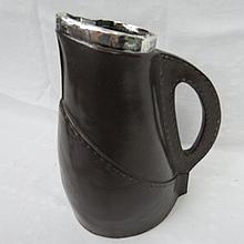 An HM silver rimmed bombard or leather black jack;