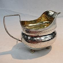 A silver cream jug, London 1810, of bellied form