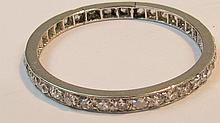 A full hoop eternity ring, the arrangement of