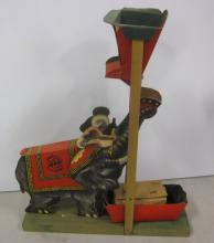 ANTIQUE CIRCUS ELEPHANT WOOD AND LITHOGRAPH PAPER MECHANICAL TOY
