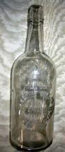 ANTIQUE LANGERT WINE CO. SPOKANE QUART EMBOSSED BOTTLE