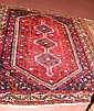 A Middle Eastern style rug with red ground