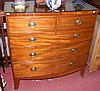 A 19th century mahogany bow front chest of two