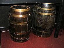 Two brass bound converted rum barrels