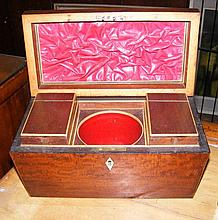A casket shaped mahogany two compartment tea caddy