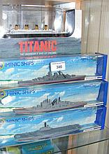 A collection of boxed Minic model ships