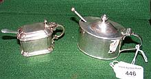 Two silver mustard pots with spoons and liners