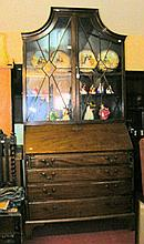 A bureau bookcase with glazed upper section and