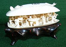 Chinese miniature ivory carving in the form of a