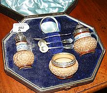 A Doulton part condiment set with silver lids and