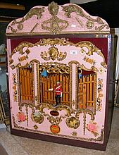 An unusual fair organ with theatre wooden surround