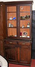 A Victorian painted pine bookcase with drawers and