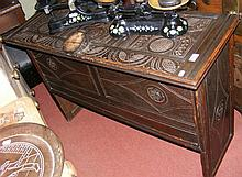 Antique coffer with carved panels
