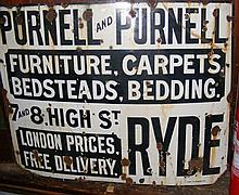 A large old enamel advertising sign for Purnell