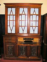 An Edwardian secretaire bookcase with glazed upper