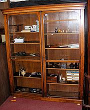 A Victorian two drawer display cabinet/bookcase