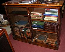 An amboyna and kingwood Victorian open bookcase -