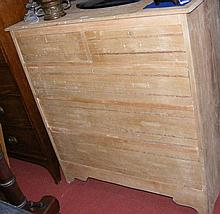 An old stripped pine chest of two short and three