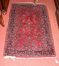 A small Middle Eastern style rug with red ground