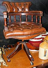 A swivel Captain's chair with button back and seat