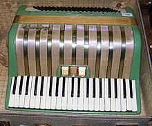 An old Hohner piano accordion in fitted carrying
